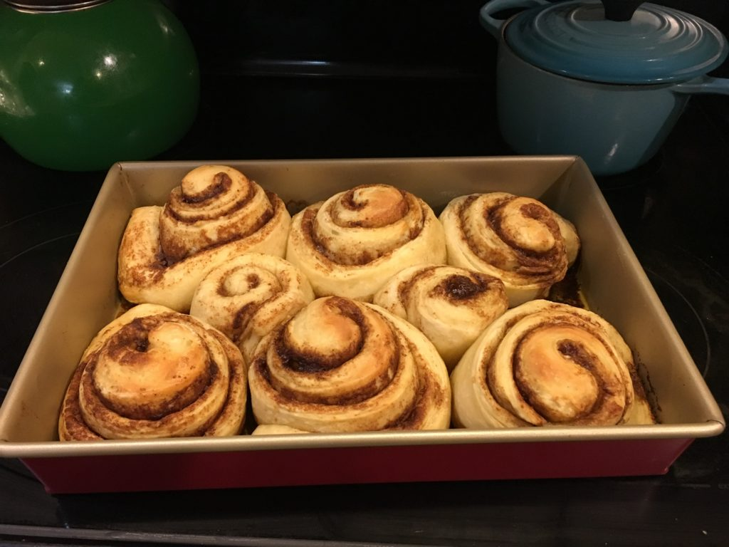 A pan of freshly baked sourdough cinnamon rolls.