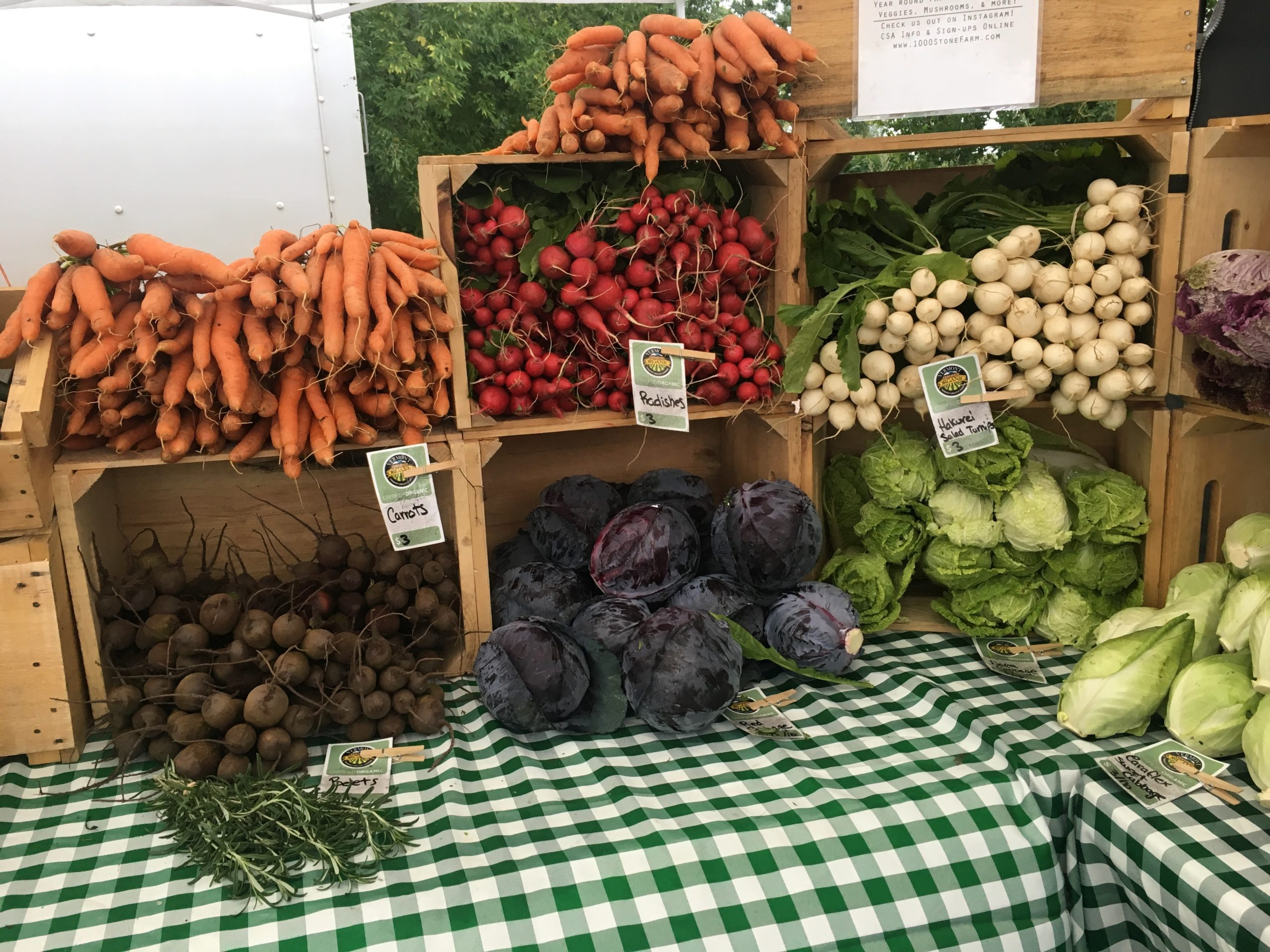 A colorful and well designed farmer's market display table.